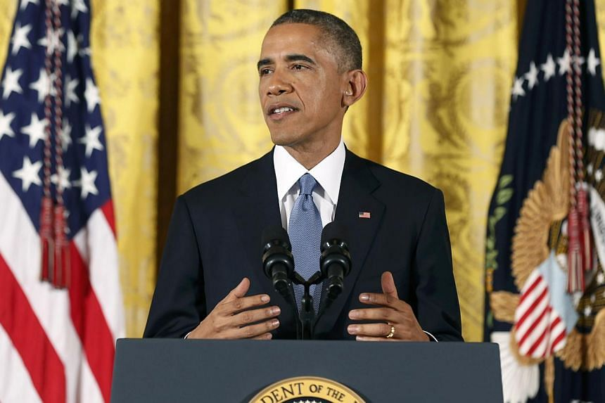 US President Barack Obama holds a news conference in the East Room of the White House in Washington, Nov 5, 2014. The President addressed reporters one day after after Republicans seized control of the US Senate and captured their biggest majority in