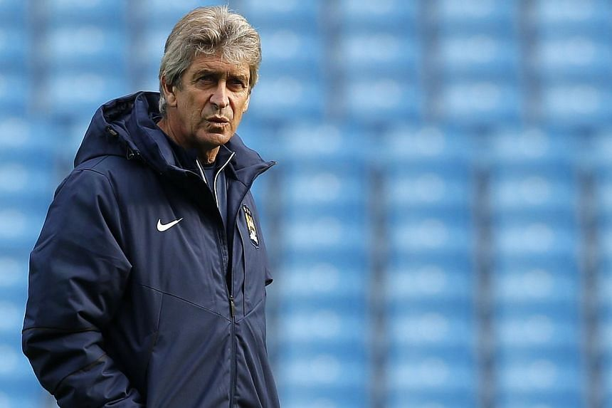 Manchester City manager Manuel Pellegrini attends a training session at Etihad Stadium in ManchesteronNov 4 before his team lost to CSKA Moscow the next day. -- PHOTO: REUTERS
