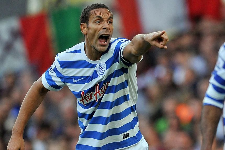 """Former England captain Rio Ferdinand - seen here in action for Queens Park Rangers on Oct 5, 2014 - """"should have known better"""" than to become involved in a Twitter row, the Football Association said Wednesday as it explained why it had controvers"""