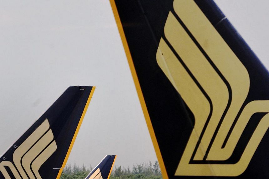 Profits at Singapore Airlines (SIA) for the three months to the end of September dipped 43.5 per cent year-on-year to $91 million. -- PHOTO: ST FILE
