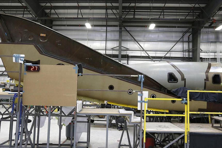 The tail of Virgin Galactic's new spaceship N202VG, which the company began building 2 and a half years ago. -- PHOTO: REUTERS