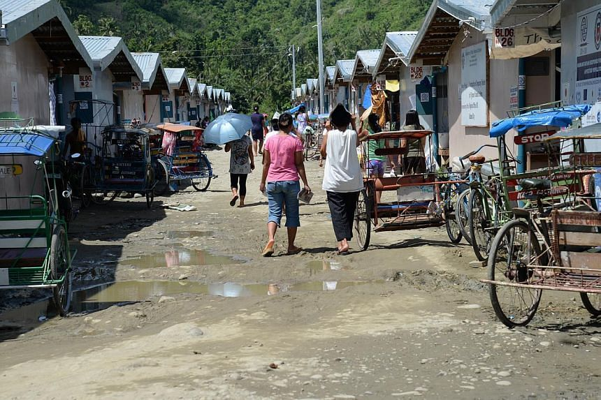 People going about their business at an evacuation centre in Caibaan village in Tacloban city. -- ST PHOTO: RAUL CAPUNPON DANCEL