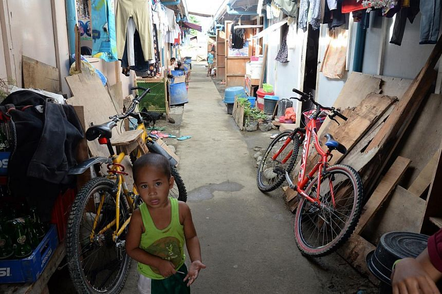 A row of bunkhouses inside a temporary settlement in Caibaan village in Tacloban city. -- ST PHOTO: RAUL CAPUNPON DANCEL