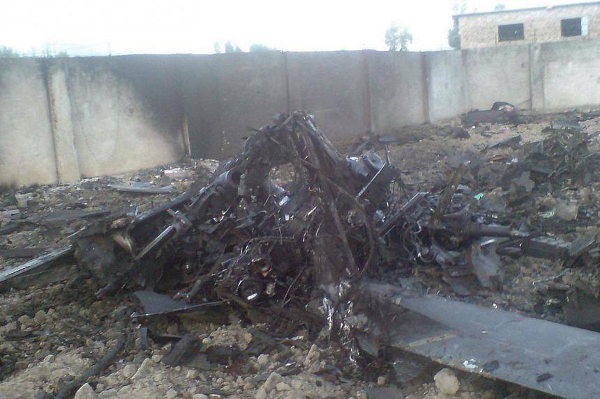 Wreckage is seen in the compound after U.S. Navy Seal commandos killed Al-Qaeda leader Osama bin Laden in Abbottabad, in this file picture. Members of the US Navy Seal commando team are now making conflicting claims as to who actually shot bin Laden.