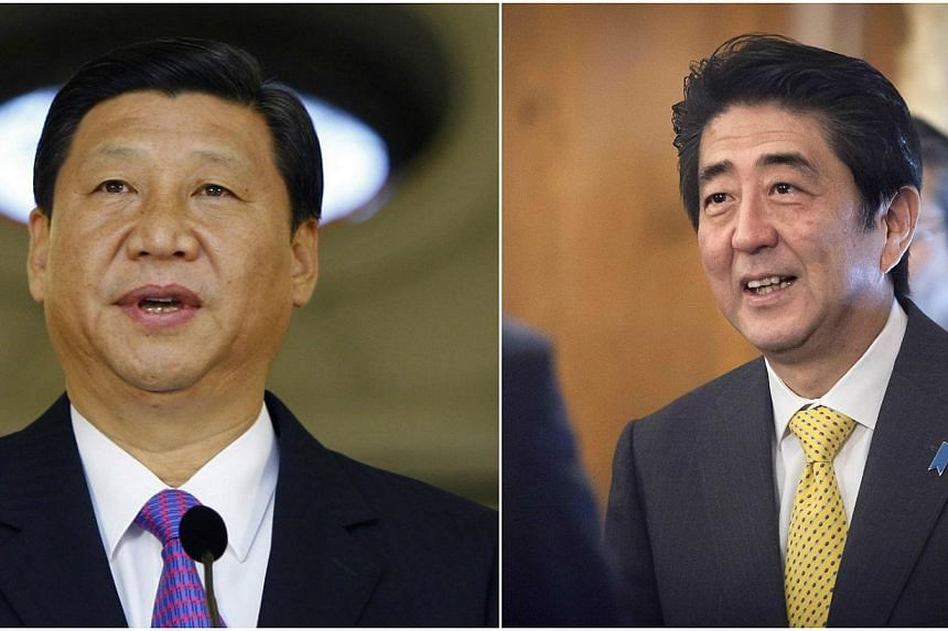 China and Japan have agreed to resume political and security dialogue disrupted by territorial and war-time historical disputes since 2012 though it remains unclear if Chinese President Xi Jinping (left) and Japanese Prime Minister Shinzo Abe would h