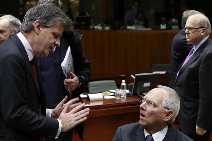 European Financial Stability, Financial Services and Capital Markets Commissioner Jonathan Hill (left) talks to German Finance Minister Wolfgang Schaeuble during an EU finance ministers meeting in Brussels on Nov 7, 2014.Britain could have unti