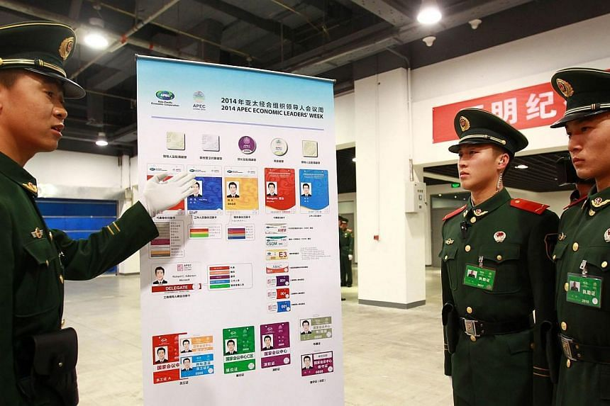This picture taken on Nov 6, 2014 shows paramilitary soldiers learning about security checking rules in the China National Convention Center, where the Asia-Pacific Economic Cooperation (APEC) annual summit is being held in Beijing. Top leaders and m