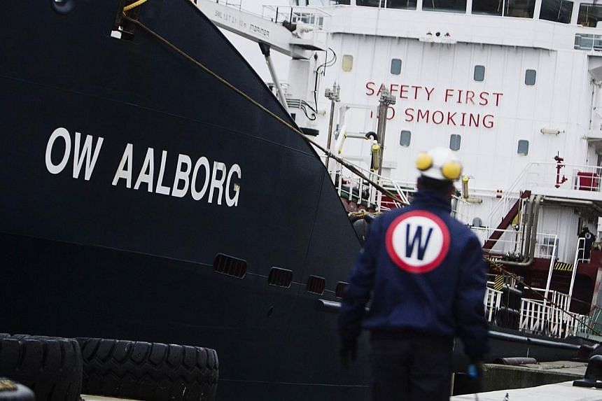 A worker of Danish ship fuel supplier OW Bunker walking in front of oil and chemical tanker OW Aalborgon Dec 1, 2010.Traders and shipping companies scrambled to source fuel and take over supply contracts on Friday after Danish marine fuel