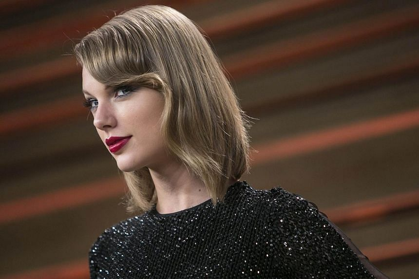 Singer Taylor Swift arrives to the 2014 Vanity Fair Oscar Party in West Hollywood, California on March 2, 2014. Conventional wisdom has it that music albums are going out of fashion. -- PHOTO: AFP