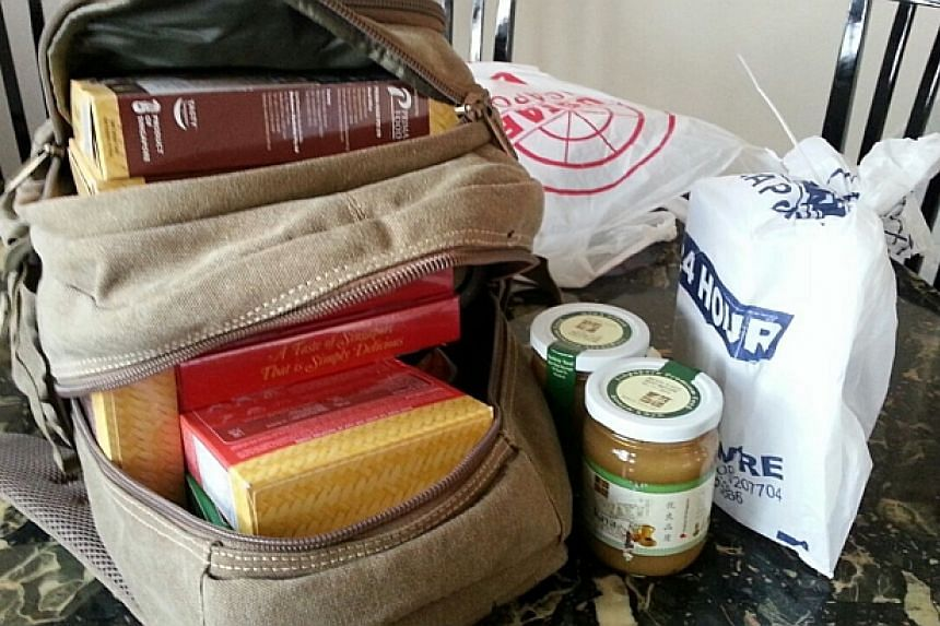 Local food items that Mr Gabriel Kang bought and packed for Mr Thoai. --PHOTO: GABRIEL KANG