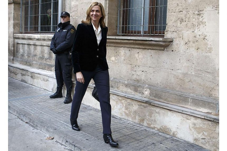 Spain's Princess Cristina, sister of King Felipe, arrives at a courthouse to testify before judge Jose Castro over tax fraud and money-laundering charges in Palma de Mallorca in this Feb 8, 2014, file photo.Spanish judges on Friday dismissed mo