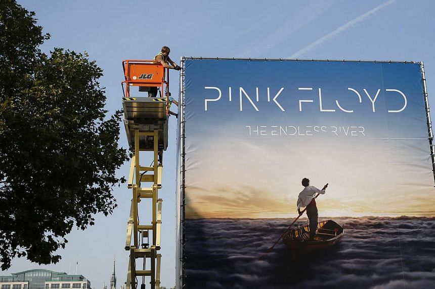 Advertising for the new Pink Floyd album The Endless River is installed on a four sided billboard on the South Bank in London on Sept 22, 2014. -- PHOTO: REUTERS