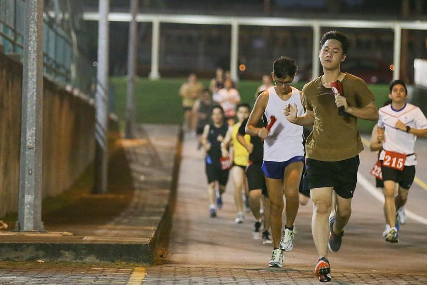 Operationally ready national servicemen running during their IPPT Preparatory Training programme in Maju Camp. The SAF has made bold moves to get rid of pain points in its physical fitness programme to help NSmen keep fit.