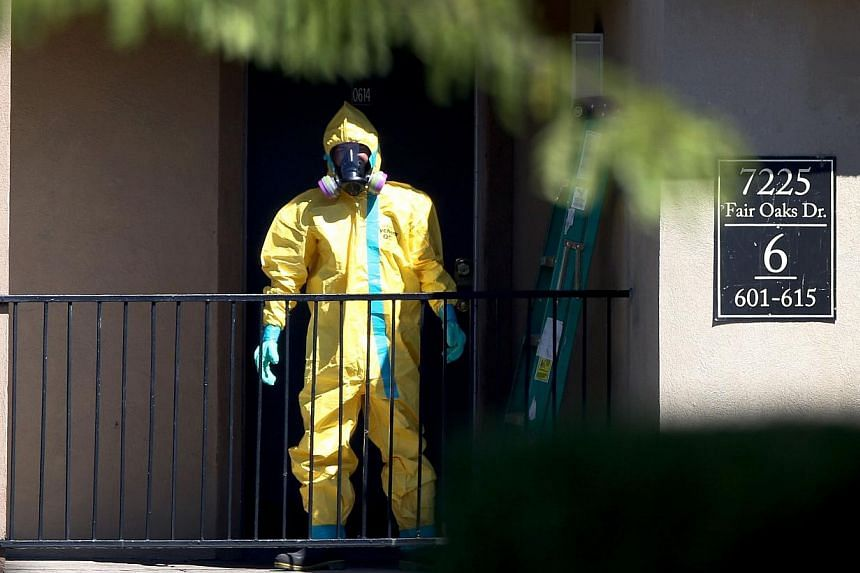 A hazmat team member arrives to clean a unit at the Ivy Apartments, where a confirmed Ebola virus patient was staying, on Oct 3, 2014 in the Texas city of Dallas. Texas is almost done watching for Ebola in people who had contact with either a Li