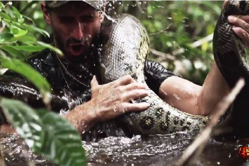 A young American naturalist, filmmaker and adventurer in the Amazon set off an Internet stir Thursday after he claimed he offered himself for dinner to a giant snake for a TV show. -- SCREENGRAB: DISCOVERY CHANNEL/ YOUTUBE