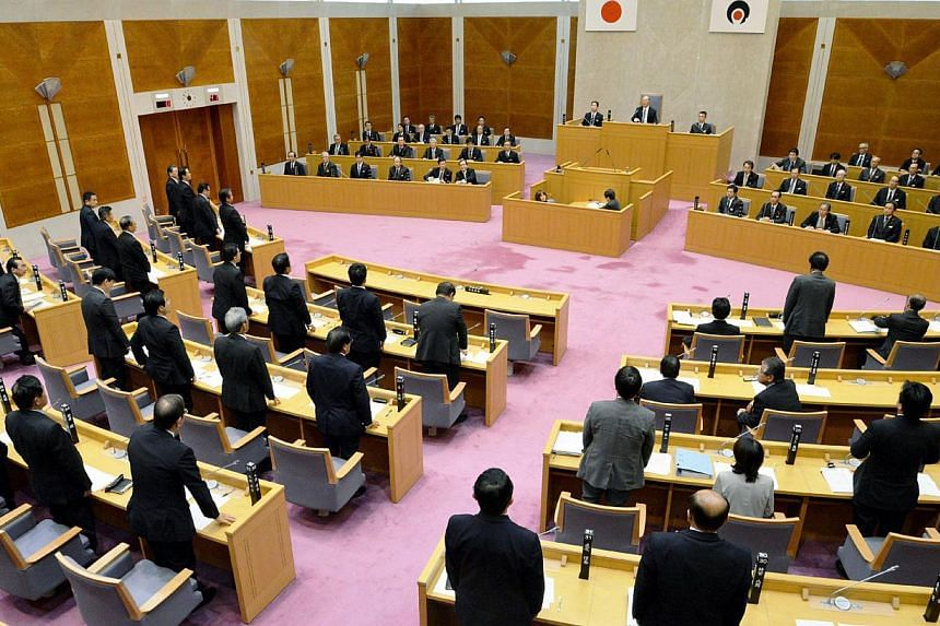 Kagoshima prefectural assembly members approving plans to restart nuclear reactors at the Kagoshima prefectural assembly in Kagoshima, Japan's southern island of Kyushu on Nov 7, 2014. A local assembly in Japan and the prefecture's governor on Nov 7