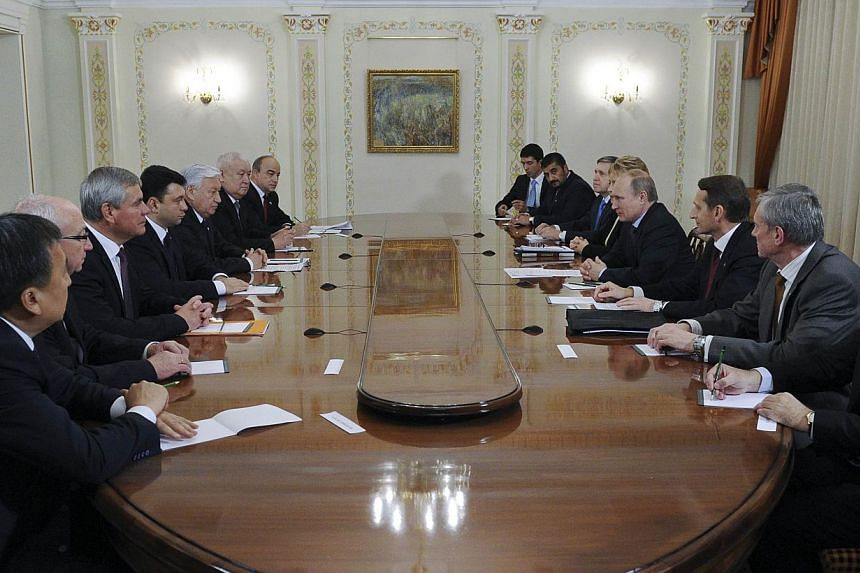 Russia's President Vladimir Putin (fourth right) attends a meeting with Parliament members of the Collective Security Treaty Organisation at the Novo-Ogaryovo state residence outside Moscow Nov 6, 2014. Putin held talks with top security chiefs on Th