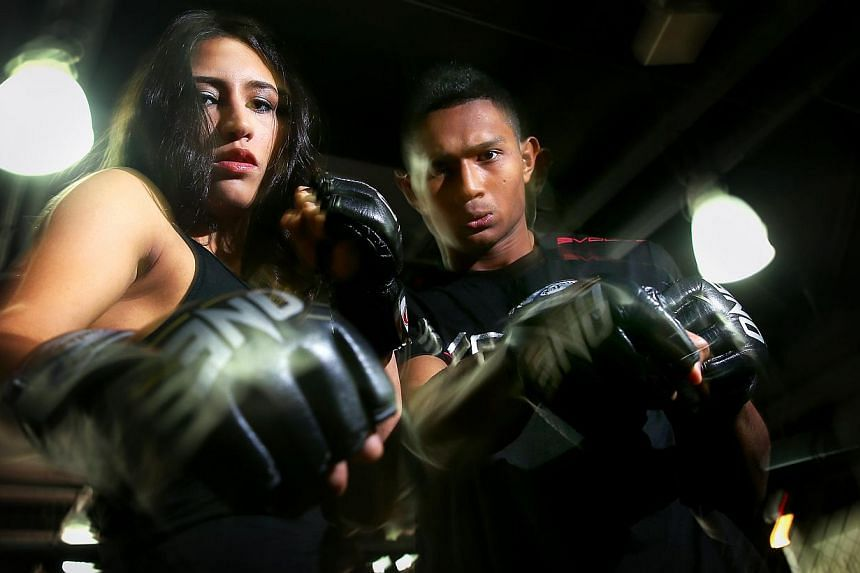 Mixed martial arts (MMA) fighters Kirstie Dunnaway and Amir Khan, who will feature at the upcoming ONE Fighting Championship (FC) event at the Singapore Indoor Stadium on Nov 7, 2014.Singapore fighters made it two wins out of two on an exciting