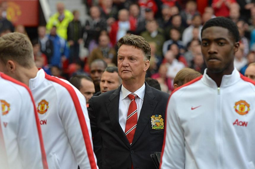 """Manchester United's Dutch manager Louis van Gaal arrives for a match between United and Everton at Old Trafford on Oct 5, 2014. A dismal start to the season and a seemingly never-ending defensive injury crisis have left van Gaal feeling """"lousy"""", he s"""