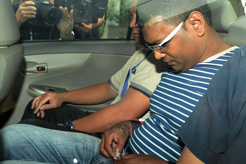 Annadurai, 42, charged with voluntarily causing hurt in committing armed robbery. -- ST PHOTO: AZIZ HUSSIN