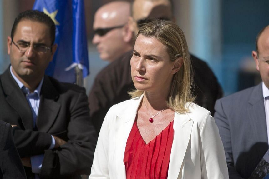 The European Union's new foreign affairs chief Federica Mogherini (centre) visits the UN-run Barhain boys school where displaced Palestinian families found refuge on Nov 8, 2014 in Gaza City. The top EU diplomat appealed on Saturday for the esta