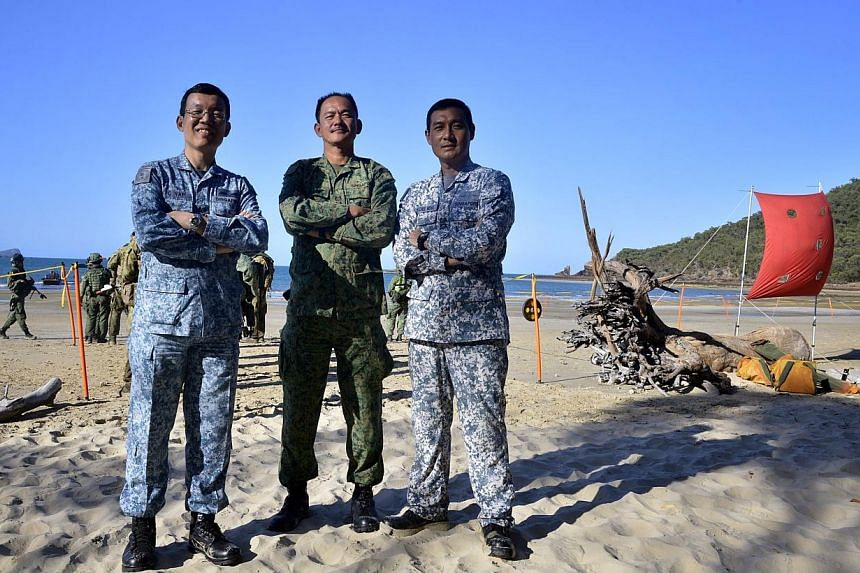 Air Director for Exercise Trident, Colonel Yap Kwee Chye (left).Deputy Chief Guards Officer, overall Exercise Director and Land Director,Colonel Lim Kwang Tang. Sea Director,Colonel Thng Chee Meng, pictured on Nov 7, 2014. -- ST PHO