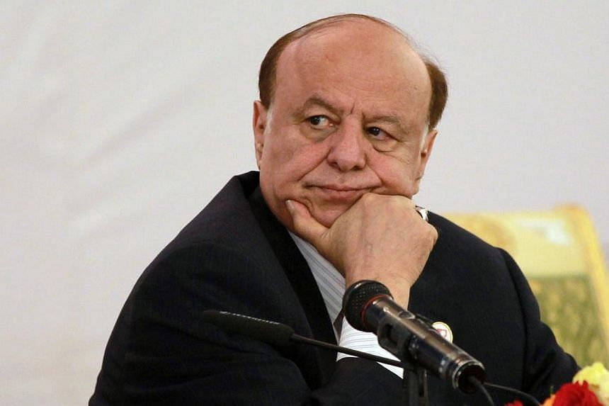 Yemen's President Abdrabuh Mansur Hadi listening during the opening session of the second national dialogue conference in the Yemeni capital, Sanaa on June 8, 2013. -- PHOTO: AFP