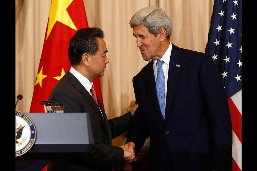 US Secretary of State John Kerry welcoming China's Foreign Minister Wang Yi at the State Department in Washington last month. US-China relations are the most important axis of East Asian international relations, affecting the entire region.