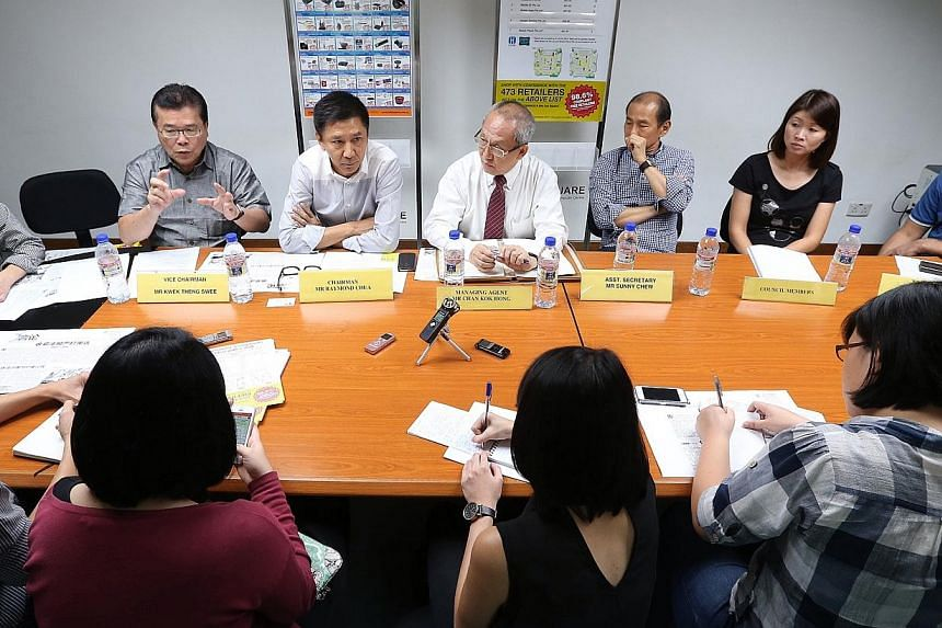 Sim Lim Square's management council members (from second left): vice-chairman Kwek Theng Swee, chairman Raymond Chua, managing agent Chan Kok Hong, assistant secretary Sunny Chew and other council members at yesterday's press conference to address is