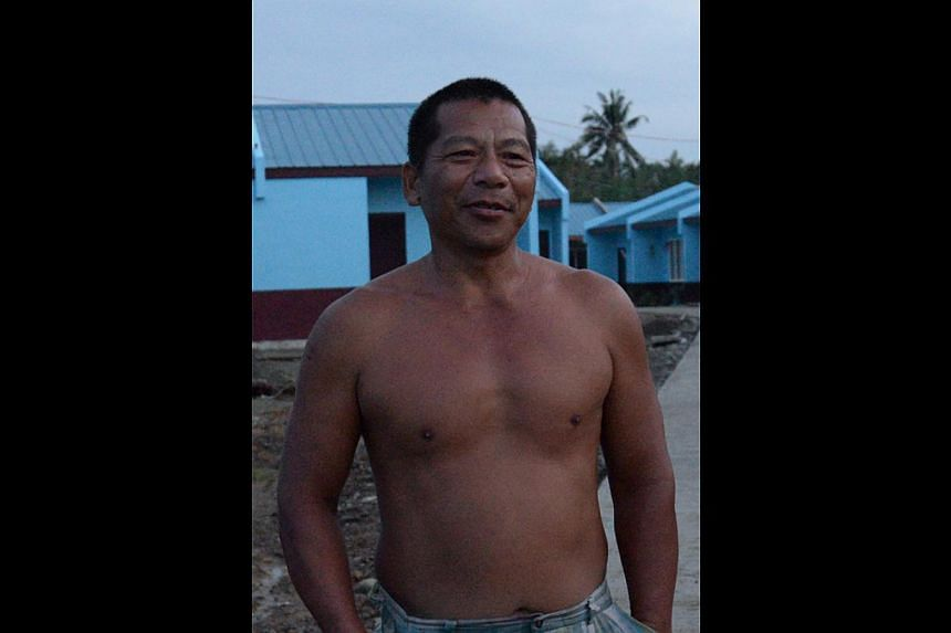 John Paul Lacandazo lost his parents and two brothers when Haiyan struck. He now lives with his grandfather. Mr Goco now has a house to call his own, but there are no street lights and no stores or clinics nearby. John Paul Aler with one of his siste