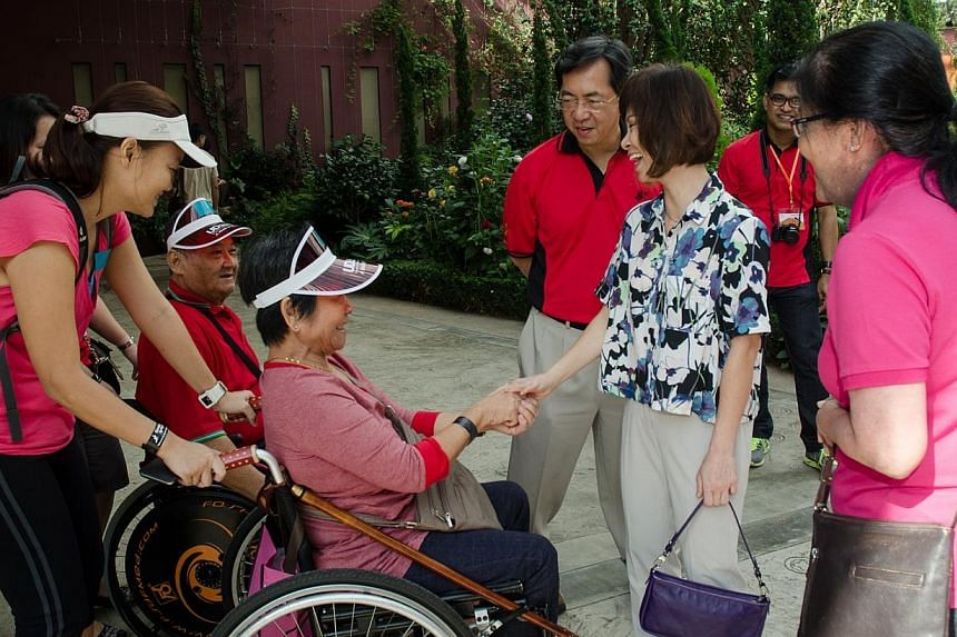 Dr Amy Khor interacts with two wheelchair users from one of the Voluntary Welfare Organisations (VWO). -- PHOTO: BCA