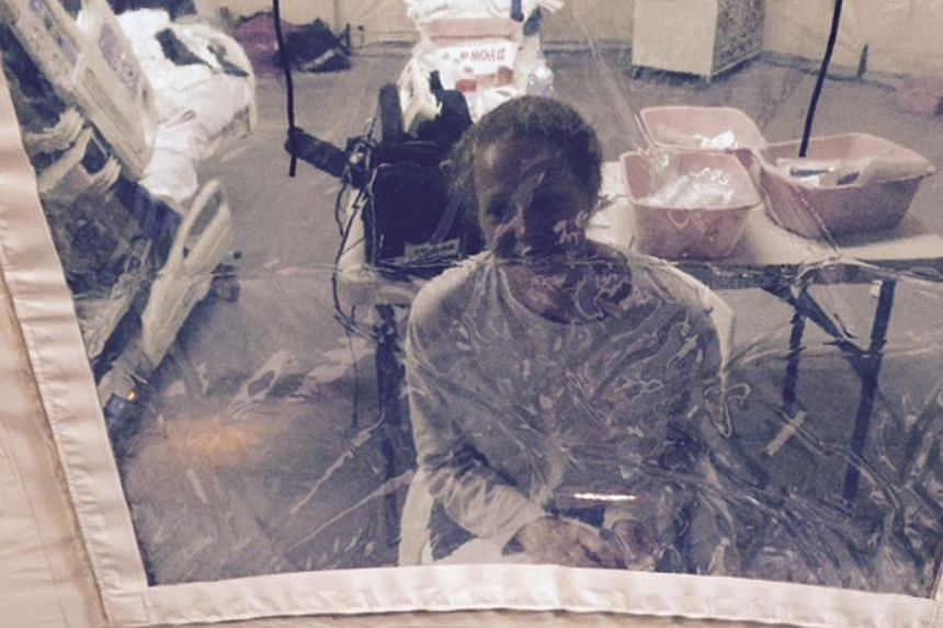Kaci Hickox, a nurse who arrived in New Jersey on Oct 24 after treating Ebola patients in West Africa, speaks to her lawyer Norman Siegel from a hospital quarantine tent in Newark, New Jersey, on Oct 26, 2014. -- PHOTO: REUTERS
