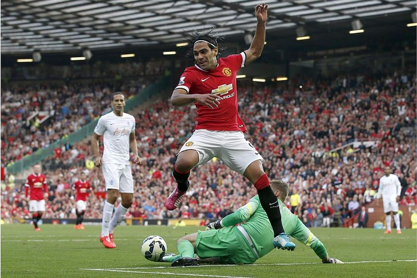 Whether it be injury or for reasons of balance, Manchester United manager Louis van Gaal has warned striker Radamel Falcao could face a lengthy absence from his top-heavy side as they struggle to find a winning formula. -- PHOTO: REUTERS