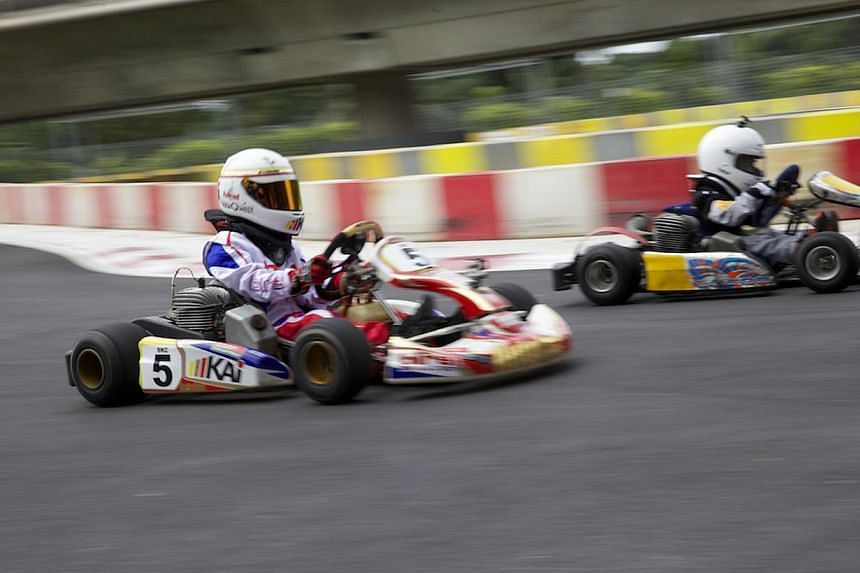 Cadet Karters aged below twelve taking their karts for a spin at the new KF1 Karting Circuit located at the Singapore Turf Club premises in Kranji. -- PHOTO: KF1 PTE LTD