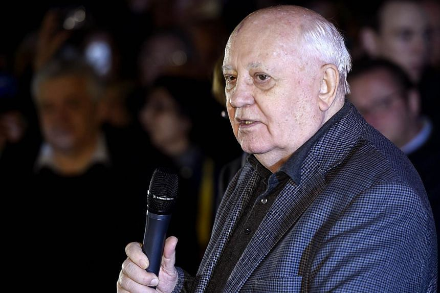 The last ruling president of the Soviet Union Mikhail Gorbachev delivers a speech as he visits the former Checkpoint Charlie border crossing on Nov 7, 2014 in Berlin.Gorbachev warned in Germany on Friday of new East-West tensions sparked by the