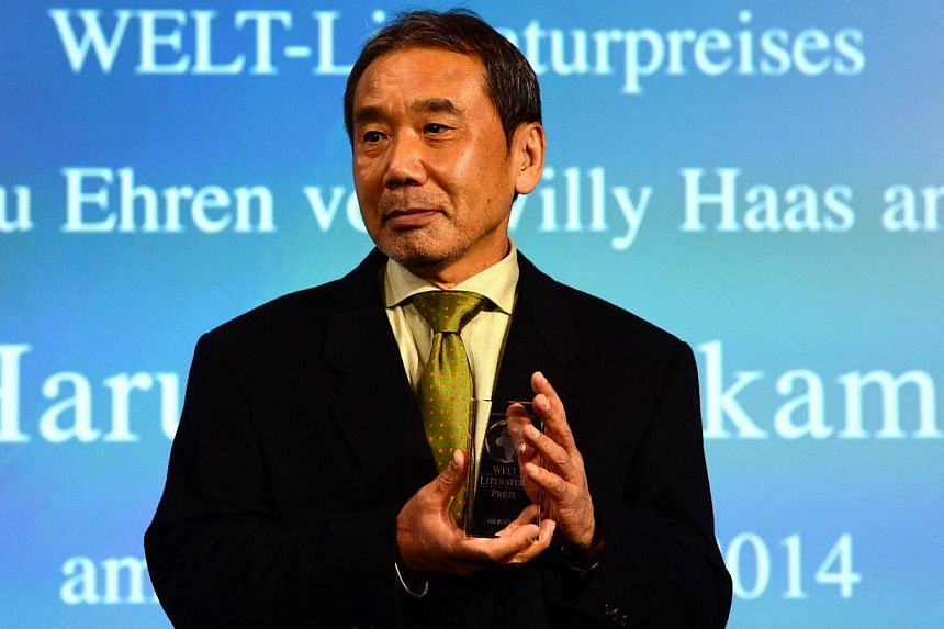 Japanese writer Haruki Murakami poses with his trophy prior to an award ceremony for the Germany's Welt Literature Prize bestowed by the German daily Die Welt, in Berlin on Nov 7, 2014. -- PHOTO: AFP