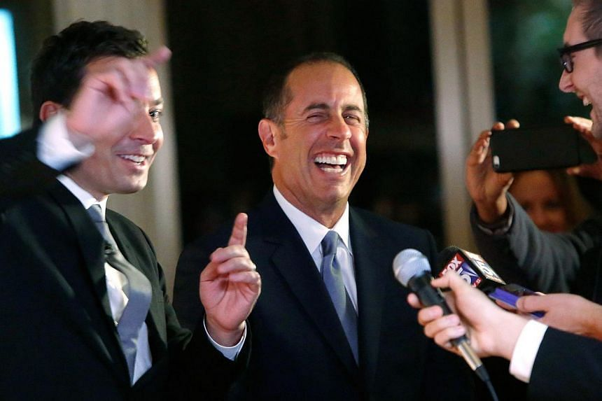 Comedians Jimmy Fallon (left) and Jerry Seinfeld (centre) laugh together as they arrive on the red carpet for the taping of the Mark Twain Prize for Humour ceremony and performance, honouring comedian Jay Leno, at the Kennedy Centre in Washington Oct