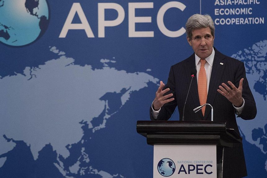 US Secretary of State John Kerry delivers a speech at the National Center for APEC annual luncheon at the Asia-Pacific Economic Cooperation (APEC) meeting in Beijing on Nov 8, 2014. -- PHOTO: AFP