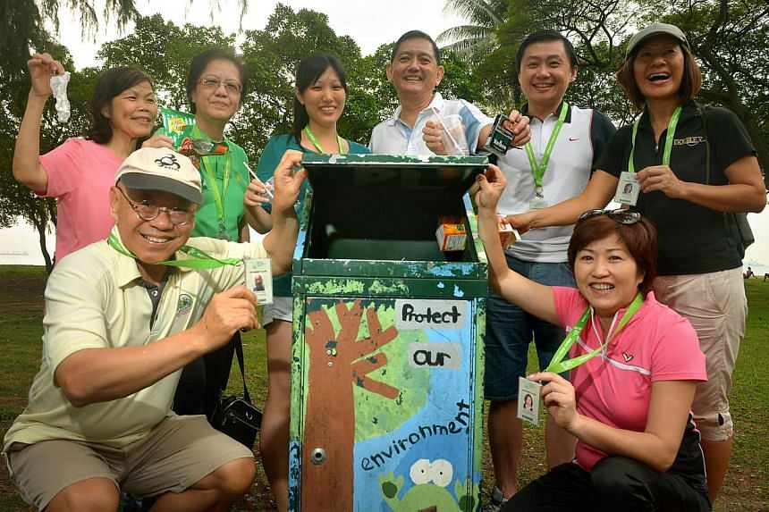 Keeping a lookout for litterbugs are volunteers (clockwise, from left) William Wan who is general secretary of the Singapore Kindness Movement, Rosalind Ng, Quek Ngor Koon, Michelle Tay, Liak Teng Lit (chairman of the Public Hygiene Council and head