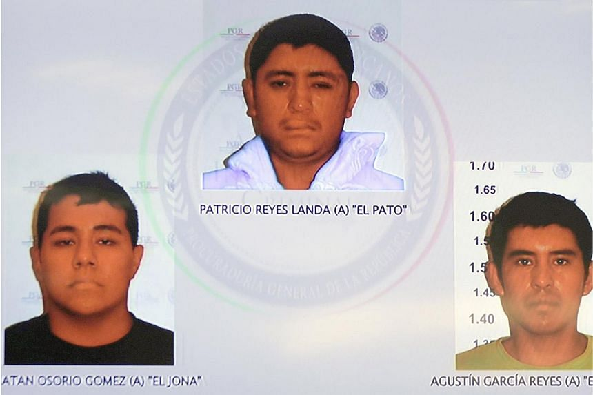 Pictures of the detainees for the case of missing students of Ayotzinapa are seen displayed on a television screen during a news conference at the Attorney General's Office building in Mexico City on Nov 7, 2014. -- PHOTO: REUTERS