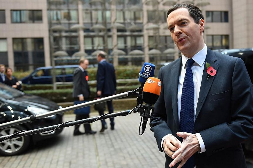 British Finance minister George Osborne talks to the press as he arrives for an economic and financial affairs meeting in Brussels on Nov 7, 2014. Britain claimed victory after EU finance ministers agreed Friday to extend a deadline for a huge
