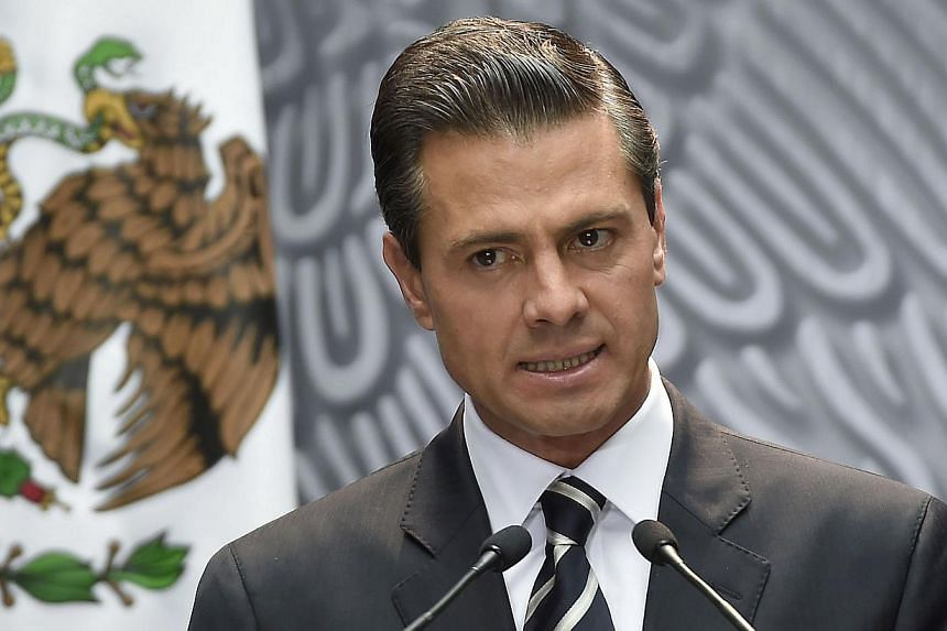 Mexican President Enrique Pena Nieto delivers a speech at the National Palace, in Mexico City, on Oct 6, 2014.Mexico's government defended on Friday its abrupt decision to scrap a bullet train deal it had just awarded to a Chinese-led consortiu