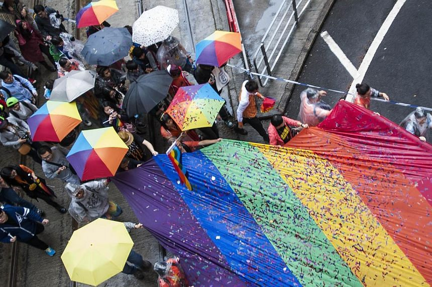 People march in Causeway Bay district during the Gay Pride Parade in Hong Kong on Nov 8, 2014. -- PHOTO: AFP