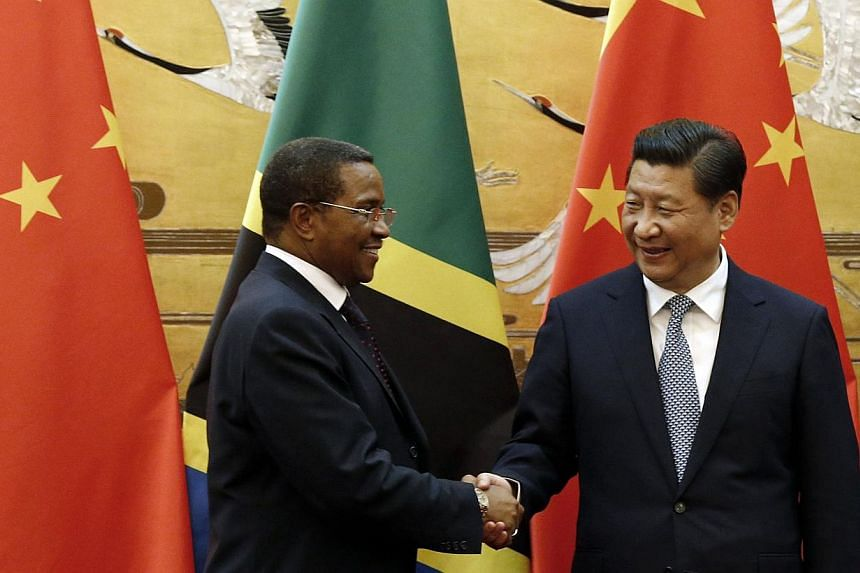Tanzania's President Jakaya Kikwete (left) shaking hands with Chinese President Xi Jinping during a signing ceremony at the Great Hall of the People in Beijing on Oct 24, 2014. Tanzania on Friday denied allegations by a campaign group that Chinese of