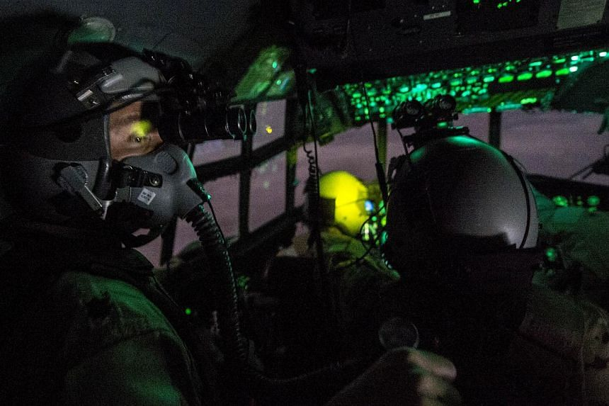 An Oct 10, 2014 US Air Force handout photo shows C-130 Hercules aircrew preparing to conduct an operational resupply airdropnear the area of Bayji, Iraq.President Barack Obama has approved sending up to 1,500 additional troops to Iraq to train