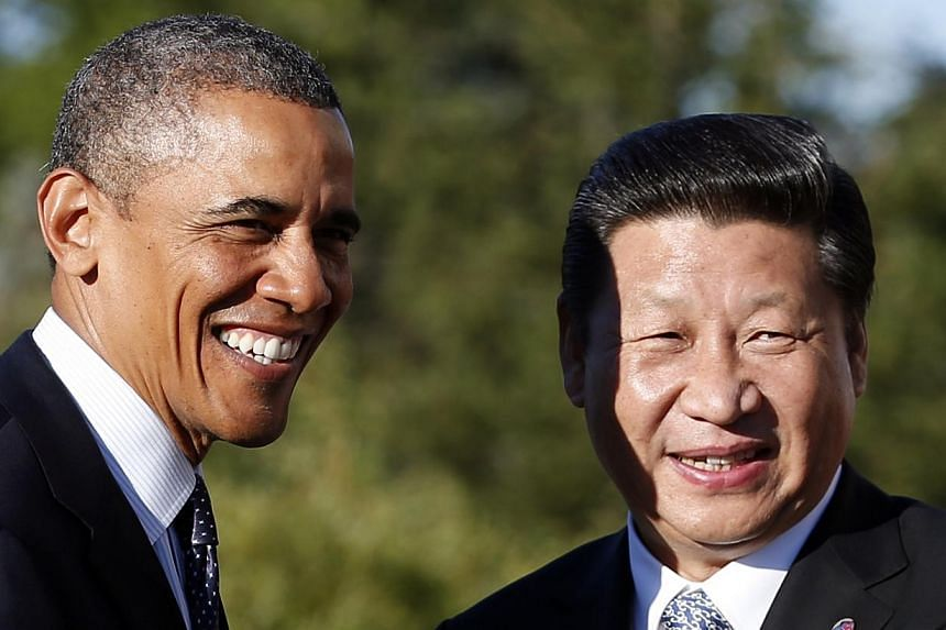 US President Barack Obama meets China's President Xi Jinping at the G-20 Summit in St Petersburg in this Sept 6, 2013 file photo. The United States is considering partnering with China on improving electricity in Africa and the proposal could be