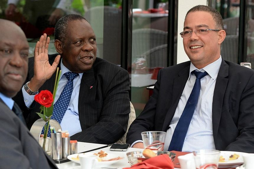 CAF president Issa Hayatou (2nd from left) speaks to Fouzi Lekjaa (right), president of the Moroccan Football Federation (FRMF), on Nov 3, 2014 in Rabat, Morocco, to discuss Morocco's request to postpone hosting the 2015 Africa Cup of Nations du