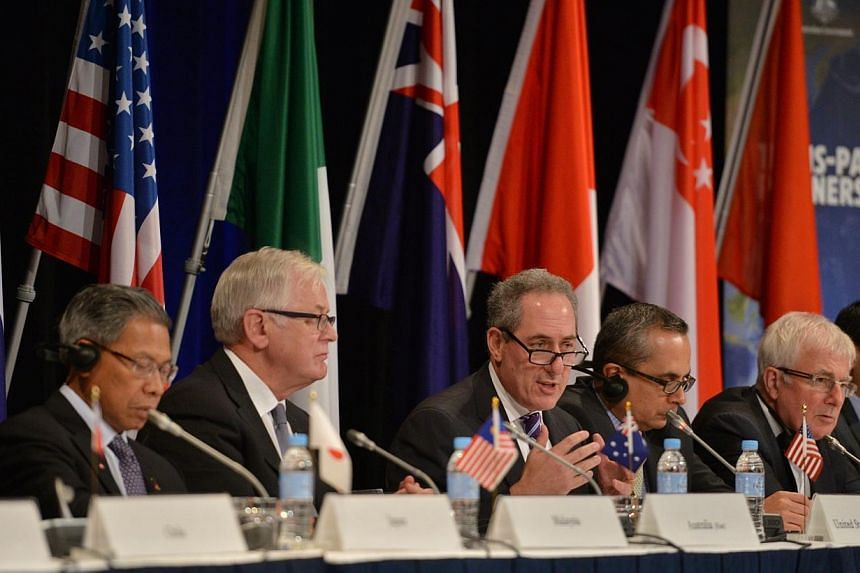 """US Trade Representative Mike Froman (centre) speaks at a press conference for the Trans-Pacific Partnership (TPP) in Sydney on Oct 27, 2014.There will be no """"major announcement"""" on a Washington-backed Asia Pacific free trade deal during a meeti"""