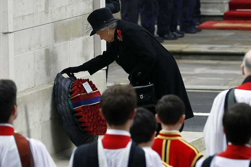 Britain's Queen Elizabeth II lays a wreath at the annual Remembrance Sunday ceremony at the Cenotaph in London Nov 9, 2014. -- PHOTO: REUTERS