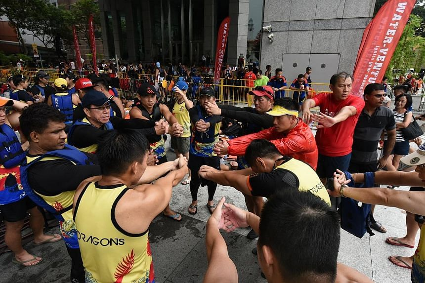 A dragon boat team warming up before their race begins.-- PHOTO: PA WATER-VENTURE